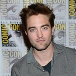 Kristen Stewart and Robert Pattinson arrive at Comic-Con 2012 120445