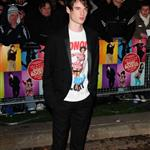 Tom Sturridge open mouth posing on the carpet for The Boat That Rocks last night in London 35436