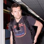 Sam Worthington at LAX with Natalie Mark 57543