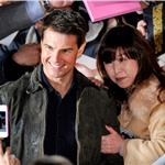 Tom Cruise poses for a picture with Japanese fans during a fan meeting to promote Mission Impossible - Ghost Protocol in Tokyo 99679