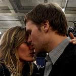 Tom Brady of the New England Patriots gets a hug from his wife Gisele Bundchen after losing to the New York Giants 104829