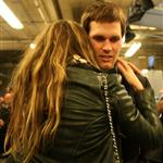 Tom Brady of the New England Patriots gets a hug from his wife Gisele Bundchen after losing to the New York Giants 104836