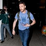 Tom Hardy arrives at LAX in Batman t-shirt 78066