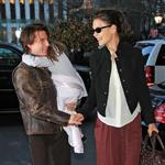 Tom Cruise presents Katie Holmes while holding Suri walking into Plaza Hotel in New York  75436