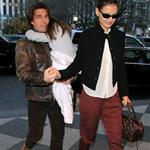 Tom Cruise presents Katie Holmes while holding Suri walking into Plaza Hotel in New York  75440