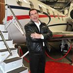 John Travolta shows impressive hair growth at Bombardier event 94789