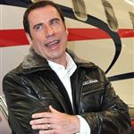 John Travolta shows impressive hair growth at Bombardier event 94790