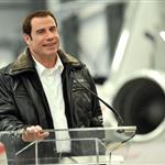John Travolta shows impressive hair growth at Bombardier event 94795