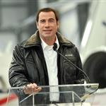 John Travolta shows impressive hair growth at Bombardier event 94796