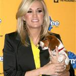 Carrie Underwood and a beagle puppy at the 6th Annual Pedigree Adoption Drive  57847