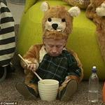 Verne Troyer in teddybear costume while eating out of honey jar 30797