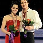 Canada's Scott Moir and Tessa Virtue pose on the podium after they won the world gold medal at the 2012 World Figure Skating Championships 110174