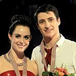 Canada's Scott Moir and Tessa Virtue pose on the podium after they won the world gold medal at the 2012 World Figure Skating Championships 110176