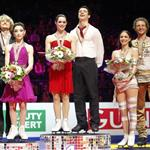 Canada's Scott Moir and Tessa Virtue pose on the podium after they won the world gold medal at the 2012 World Figure Skating Championships 110177