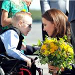 Prince William and Catherine presented flowers as they board their plane in Yellowknife  89347