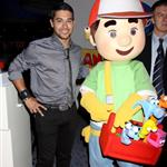 Wilmer Valderrama in Vegas posing next to a stuffed doll because he is celebrity poor 40349