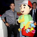 Wilmer Valderrama in Vegas posing next to a stuffed doll because he is celebrity poor 40350