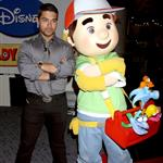 Wilmer Valderrama in Vegas posing next to a stuffed doll because he is celebrity poor 40351