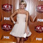 Carrie Underwood arrives at the 2011 American Country Awards  96480