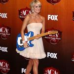 Carrie Underwood arrives at the 2011 American Country Awards  96485