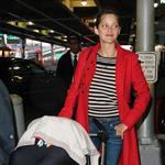 Marion Cotillard in red coat and stripes arriving in New York with son Marcel  95746