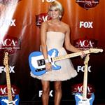 Carrie Underwood arrives at the 2011 American Country Awards  96490
