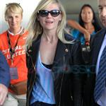 Kirsten Dunst and Garrett Hedlund arrive at Toronto's Pearson International Airport for TIFF 107346